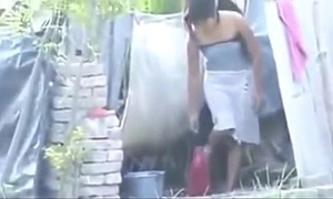 Indian sexy village girl ablution outside,