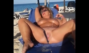 My slattern get hitched is masturbating size people in front beach